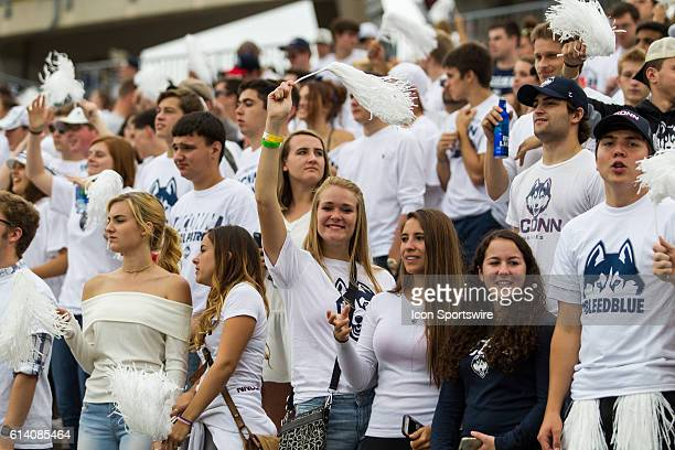 UConn fans celebrate a touchdown during the first half of a NCAA football game between AAC rivals the Cincinnati Bearcats and the UConn Huskies at...