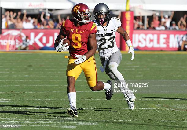 USC JuJu SmithSchuster makes a catch past Colorado Ahkello Witherspoon during the game at the Los Angeles Memorial Coliseum in Los Angeles CA