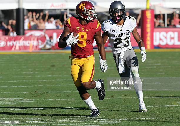 USC JuJu SmithSchuster runs past Colorado Ahkello Witherspoon during the game at the Los Angeles Memorial Coliseum in Los Angeles CA