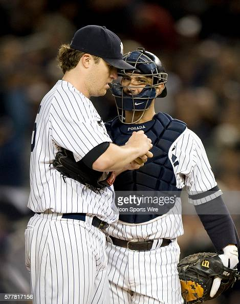 NY Yankees Vs Minnesota Twins Game 3 ALDS Yankees starting pitcher Phil Hughes talks with Jorge Posada in the 6th inning