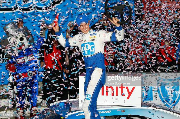 Joey Logano celebrates in Victory Lane after winning the Drive For The Cure 300 NASCAR Xfinity series racers the Charlotte Motor Speedway in Concord...