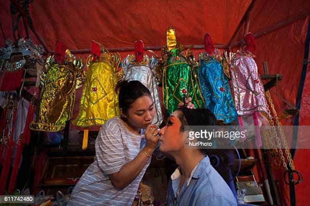 October 1 2016 a Chinese opera troupe apply makeup before performing at Joe Sue Kung Shrine Chinese temple during the annual vegetarian festival in...