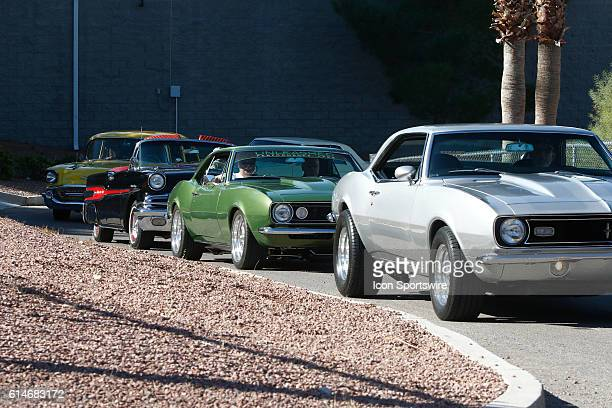 Cars line up after registering for the Show Shine Car Show during the 350 Fest prior to the DC Solar 350 NASCAR Camping World Truck Series race at...