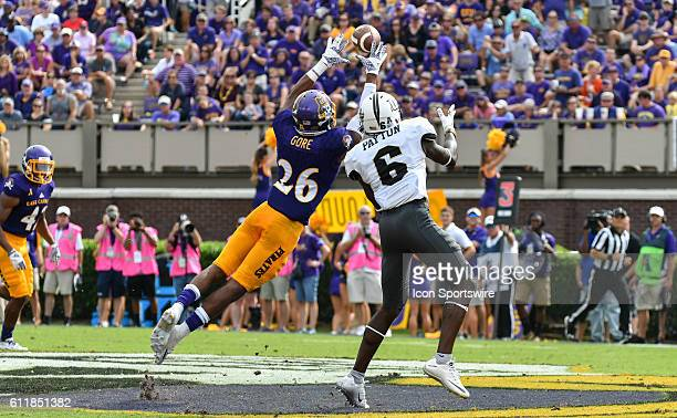 East Carolina Pirates defensive back Colby Gore intercepts a pass intended for UCF Knights wide receiver Tristan Payton in a game between the East...