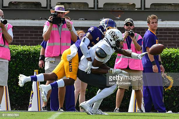 East Carolina Pirates defensive back Colby Gore breaks up a pass intended for UCF Knights wide receiver Tre'Quan Smith in a game between the East...