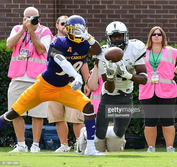 East Carolina Pirates defensive back DaShaun Amos breaks up a pass intended for UCF Knights wide receiver Tre'Quan Smith in a game between the East...
