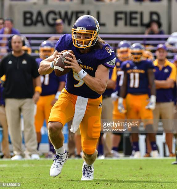 East Carolina Pirates quarterback Philip Nelson scrambles in a game between the East Carolina Pirates and the Central Florida Knights at DowdyFicklen...