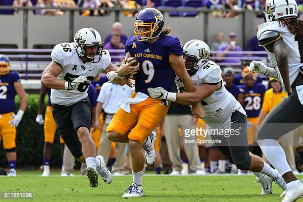 East Carolina Pirates quarterback Philip Nelson is tackled by UCF Knights defensive lineman Joey Connors in a game between the East Carolina Pirates...