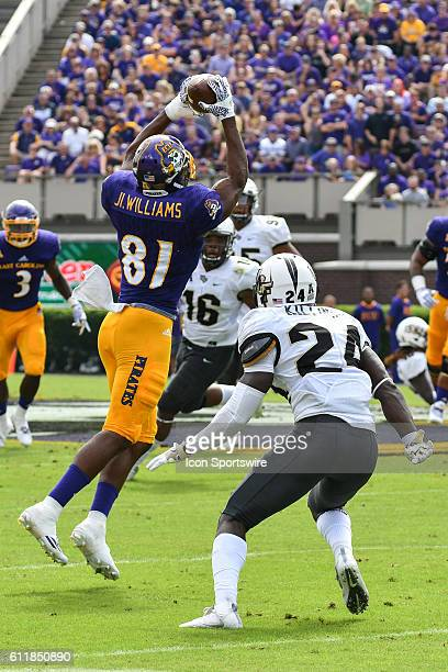 East Carolina Pirates wide receiver Jimmy Williams catches a pass over UCF Knights defensive back DJ Killings in a game between the East Carolina...