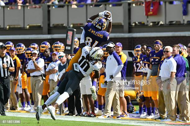 East Carolina Pirates wide receiver Jimmy Williams is unable to come down in bounds with a reception over UCF Knights defensive back Shaquill Griffin...