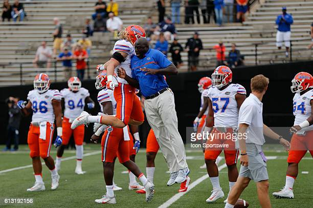 Florida defensive line coach Chris Rumph and Florida Gators inside linebacker Alex Anzalone chest bump before a 136 win by Florida over Vanderbilt at...