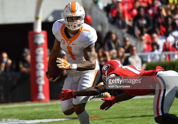 Jalen Hurd Tennessee Volunteers running back rushes attempts to get past the tackle of Malkom Parrish Georgia Bulldogs defensive back during the game...