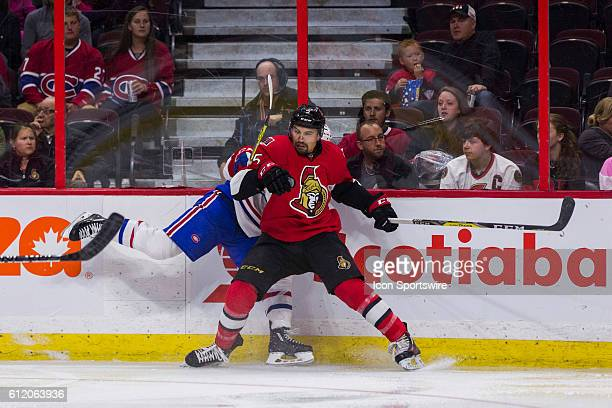 Ottawa Senators Cody Ceci checks Montreal Canadiens Charles Hudon during second period National Hockey League preseason action between the Montreal...