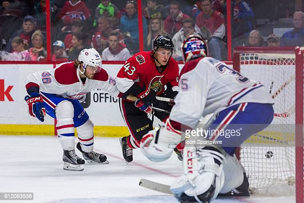 Ottawa Senators Ryan Dzingel tries to escape Montreal Canadiens Brett Lernout for an attempt on Canadiens goalie Al Montoya during third period...