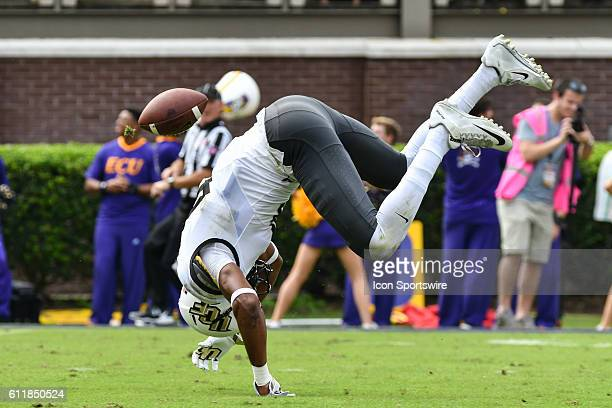 UCF Knights wide receiver Tre'Quan Smith flips after missing a catch in a game between the East Carolina Pirates and the Central Florida Knights at...