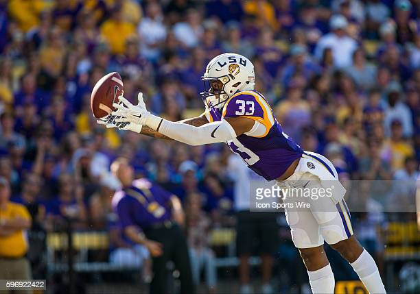 LSU Tigers safety Jamal Adams reaches to grab the ball before it bounces in the end zone during the game between the South Carolina Gamecocks and the...