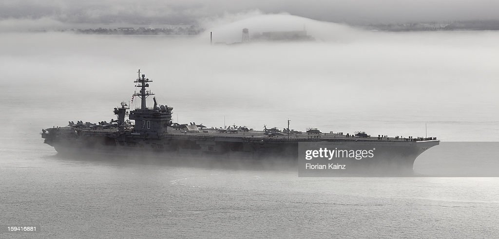 CONTENT] October 11, 2011 - the aircraft carrier USS Carl Vinson (CVN-70) leaves the San Francisco Bay on a foggy morning, a couple of days after Fleet Week 2011 in San Francisco. Alcatraz Island can be seen in the background, partially hidden by fog.