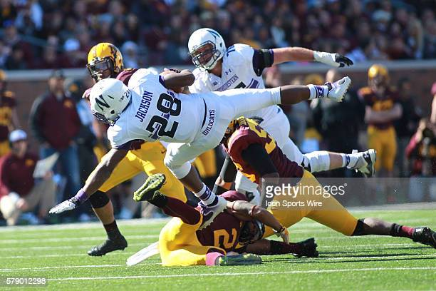 October 11 2014 Wildcats running back Justin Jackson is up ended by Gophers linebacker Damien Wilson and Gophers defensive back Cedric Thompson...