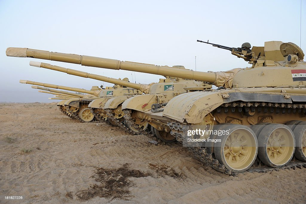 October 14, 2008 - Iraqi T-72 tanks from Iraqi Army Brigade sit on line at the end of a cordon and search training exercise at Camp Taji, Iraq.