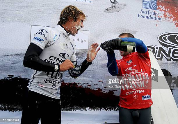 2010 O'Neill Coldwater Classic winner Australian Josh Kerr sprays secondplace finisher Eric Geiselman with champagne at North Chesterman Beach in...