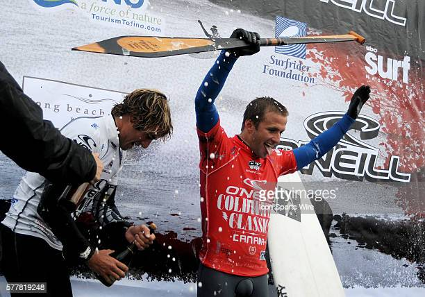 Australian Josh Kerr celebrates his O'Neill Coldwater Classic win as secondplace finisher Eric Geiselman pops a bottle of champagne at North...