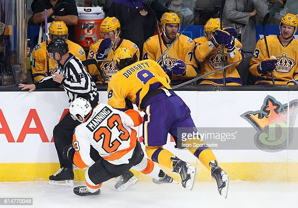 Philadelphia Flyers Defenceman Brandon Manning gets hit by Los Angeles Kings Defenceman Drew Doughty during the game at Staples Center in Los Angeles...