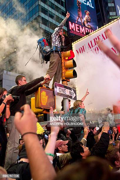 October 15 2011 Demonstrators taking part in the 'Occupy Wall Street' protest movement gather in Times Square The movement has spread throughout the...