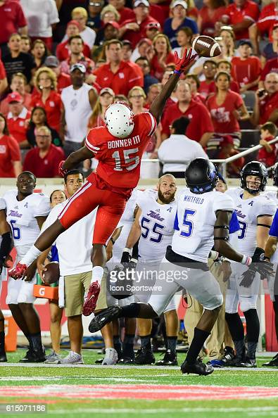 A late second half pass goes off the fingertips of Houston Cougars wide receiver Linell Bonner as Tulsa Golden Hurricane linebacker Tim Quickel...