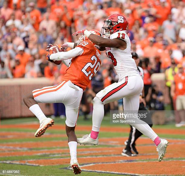 Clemson cornerback Marcus Edmond pulls in the interception in front of NC States Josh Jones in overtime to seal the victory during overtime action...