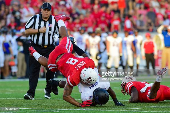 Houston Cougars linebacker Emeke Egbule and Tulsa Golden Hurricane running back D'Angelo Brewer are flipped as a result of a hard hit by Houston...