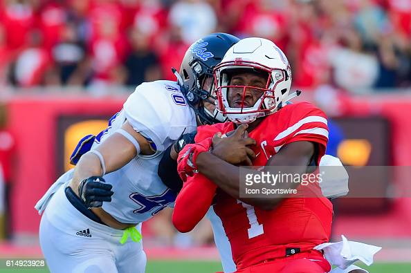 Houston Cougars quarterback Greg Ward Jr is brought down by Tulsa Golden Hurricane linebacker Trent Martin after a moderate gain during the Tulsa...