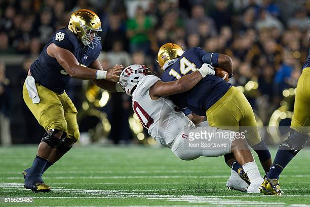 Stanford Cardinals defensive end Solomon Thomas sacks Notre Dame Fighting Irish quarterback DeShone Kizer during the NCAA football game between the...