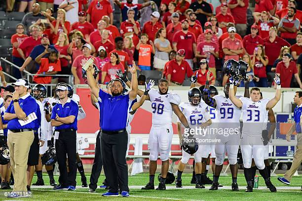 The Tulsa bench signals a touchdown on the last play of the game as the Houston crowd watches the replay on the Jumbotron during the Tulsa Golden...