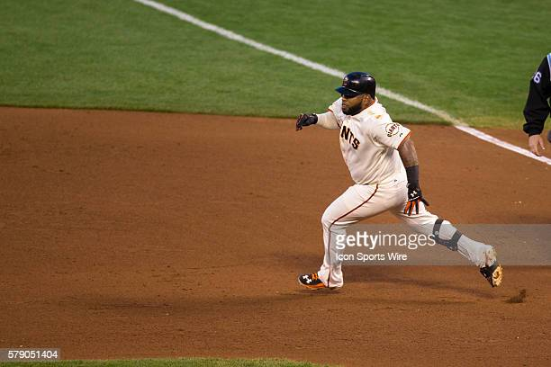 San Francisco Giants third baseman Pablo Sandoval beds to second base after getting a double in the 4th inning during game 5 of the National League...