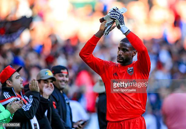 DC United goalkeeper Bill Hamid salutes the fans at the end of a MLS match at RFK Stadium in Washington DC DC United defeated New York City FC