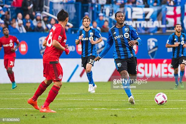 Montreal Impact Midfielder Patrice Bernier kicking the ball away from him to a teammate during the Toronto FC versus the Montreal Impact game at...