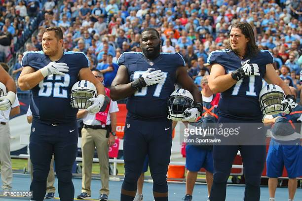 Tennessee Titans Center Brian Schwenke Tennessee Titans Offensive Guard Quinton Spain and Tennessee Titans Offensive Tackle Dennis Kelly place their...