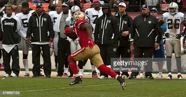San Francisco 49ers running back Frank Gore makes big run in front of Raiders bench on Sunday October 17 2010 at Candlestick Park in San Francisco...