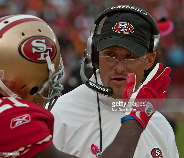 San Francisco 49ers running back Frank Gore talks to coach Tom Rathman on Sunday October 17 2010 at Candlestick Park in San Francisco California The...