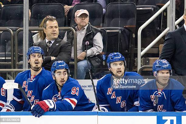 New York Rangers Head Coach Alain Vigneault watches on as the Sharks works in the Rangers zone during the first period of a NHL game between the San...