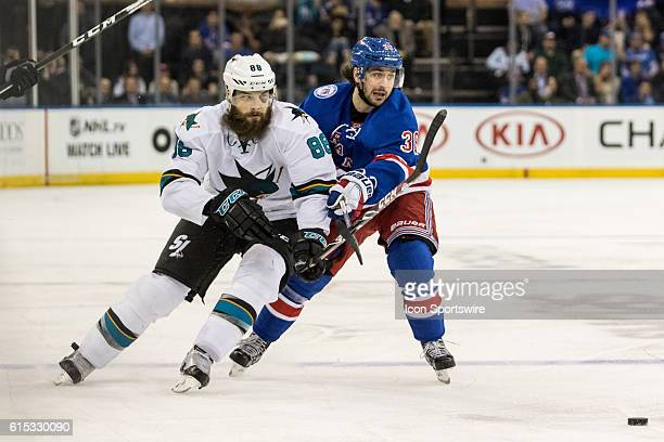 New York Rangers Right Wing Mats Zuccarello tries to keep San Jose Sharks Defenseman Brent Burns clear of the puck during the third period of a NHL...