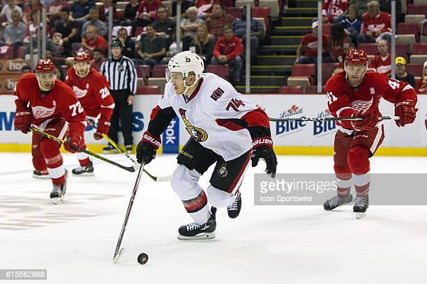 Ottawa Senators defenseman Thomas Chabot skates with the puck during the regular season home opener NHL hockey game between the Ottawa Senators and...