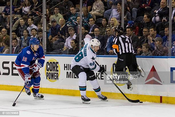 Referee Wes McCauley leaps out of the way of San Jose Sharks Right Wing Melker Karlsson as he works the puck around the net during the first period...