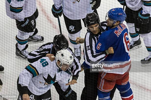 Referees separate New York Rangers Defenseman Dylan McIlrath and San Jose Sharks Center Tomas Hertl during the second period of a NHL game between...
