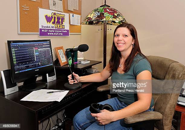 October 18 2013 Kristie Doyle who runs a community internet radio station out of her house in Raymond in memory of her late uncle sits in his chair...