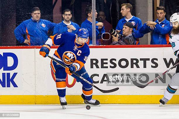 New York Islanders Center John Tavares with the puck against the boards during the first period of a NHL game between the San Jose Sharks and the New...