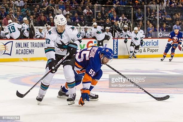 New York Islanders Denfenseman Johnny Boychuk reaches down and blocks a pass to San Jose Sharks Center Tommy Wingels during the first period of a NHL...