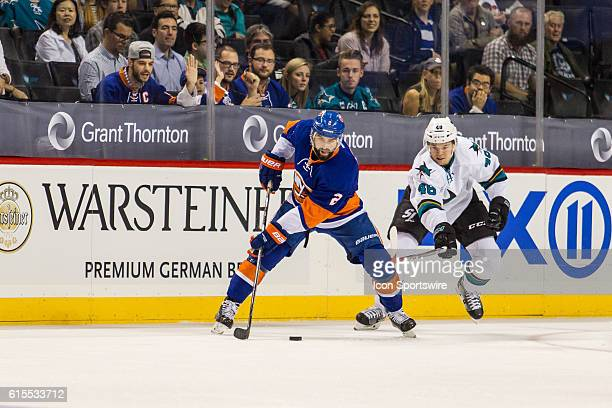New York Islanders Denfenseman Nick Leddy works around San Jose Sharks Defenseman Dan Kelly during the first period of a NHL game between the San...
