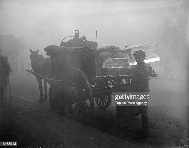 An iceman is busy delivering ice despite a London fog