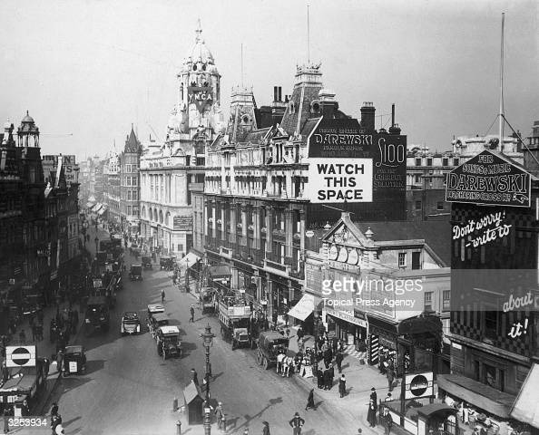 Tottenham Court Road at the junction with Oxford Street and Charing Cross Road London The Court Playhouse is on the right and the Underground station...